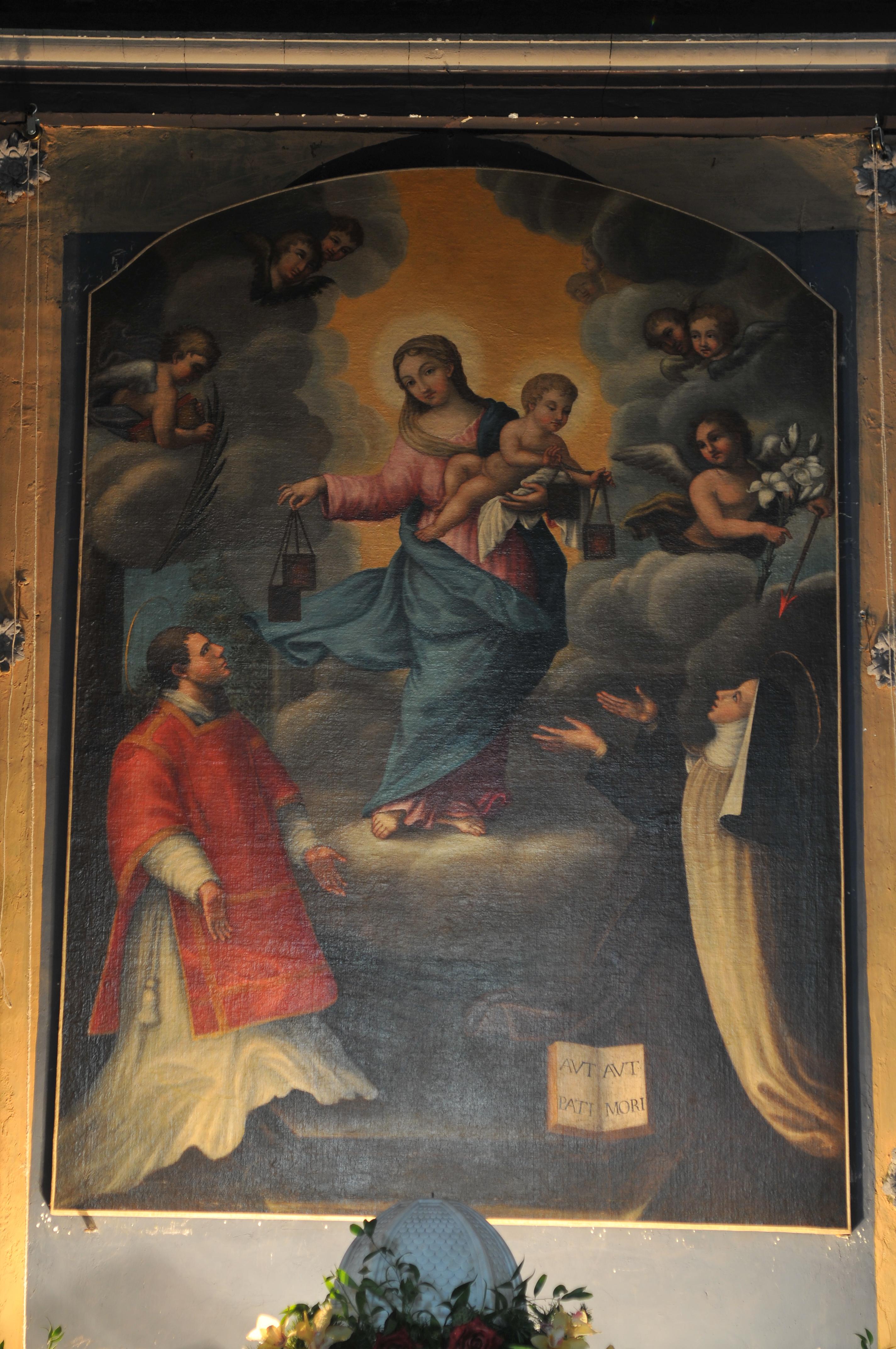 ill.24: pala raffigurante la Madonna e Bambino che porgono gli scapolari ai santi Lorenzo e Teresa d'Avila